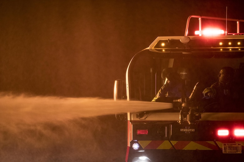 Firefighters from the 23d Civil Engineer Squadron use a P-23 Airport Rescue Fire Fighting vehicle during nighttime, live-fire training, Jan. 10, 2017, at Moody Air Force Base, Ga. The P-23 is primarily used to respond to aircraft fuel fires using its 3,300 gallons of water, 500 gallons of fire-retardant foam and 500lbs of dry powder. There are 250 P-23s in the Air Force inventory across active duty, Air National Guard and Air Force Reserve bases. (U.S. Air Force photo by Staff Sgt. Ryan Callaghan)