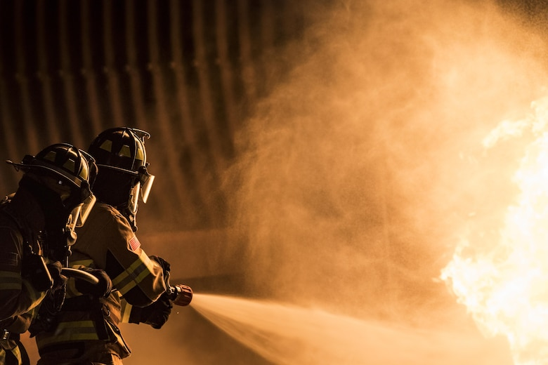 Firefighters from the 23d Civil Engineer Squadron extinguish a flame during nighttime, live-fire training, Jan. 10, 2017, at Moody Air Force Base, Ga. This training is an annual requirement for Moody firefighters and is just one of the ways they stay ready to protect people, property and the environment from fires and disasters. (U.S. Air Force photo by Staff Sgt. Ryan Callaghan)