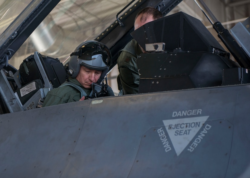 Brig. Gen. Eric Sanchez, the Commanding General at White Sands Missile Range, receives instruction from Maj. Brent Ellis, a fighter pilot with the 311th Fighter Squadron, prior to a familiarization flight in an F-16 Fighting Falcon, at Holloman Air Force Base, N.M., on Jan 9, 2017. Sanchez was offered a flight in an F-16 Fighting Falcon to gain a better understanding of the aircraft's mission and its capabilities. (U.S. Air Force photo by Airman 1st Class Alexis P. Docherty)