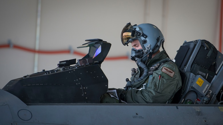 Maj. Brent Ellis, a fighter pilot with the 311th Fighter Squadron, performs pre-flight checks prior to a flight at Holloman Air Force Base, N.M., on Jan. 9, 2017. Ellis flew Brig. Gen. Eric Sanchez, the Commanding General at White Sands Missile Range, on a familiarization flight in an F-16 Fighting Falcon, to demonstrate Holloman's F-16 mission, and the aircraft's capabilities. (U.S. Air Force photo by Airman 1st Class Alexis P. Docherty)