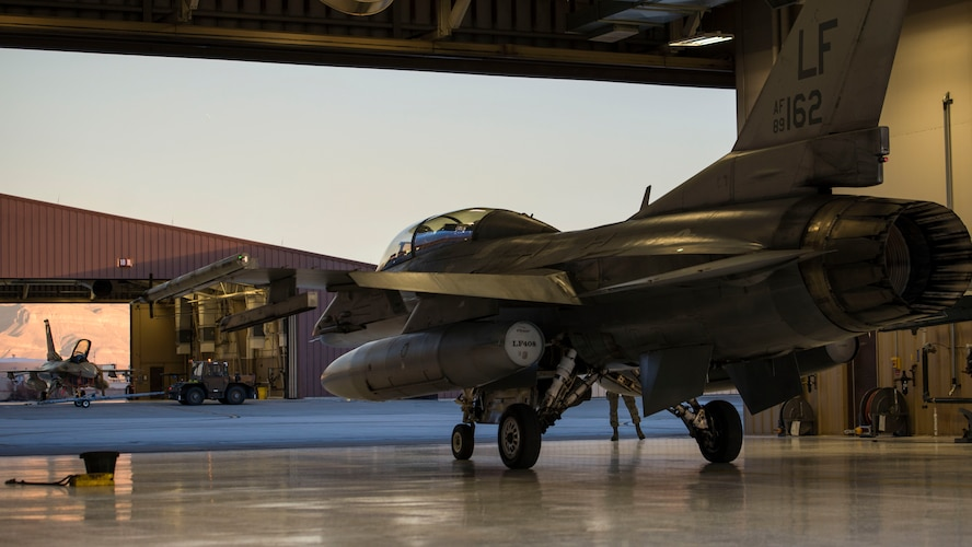 An F-16 Fighting Falcon piloted by Maj. Brent Ellis, a fighter pilot with the 311th Fighter Squadron, prepares to exit a hangar, at Holloman Air Force Base, N.M., on Jan. 9, 2017. Ellis flew Brig. Gen. Eric Sanchez, the Commanding General at White Sands Missile Range, on a familiarization flight to demonstrate Holloman's F-16 mission and the aircraft's capabilities. Sanchez visited Holloman AFB to attend an airspace and mission brief related to Holloman and WSMR's ongoing partnership. (U.S. Air Force photo by Airman 1st Class Alexis P. Docherty)