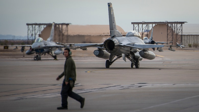An F-16 Fighting Falcon piloted by Maj. Brent Ellis, a fighter pilot with the 311th Fighter Squadron, heads toward the flight line at Holloman Air Force Base, N.M., on Jan. 9, 2017. Ellis flew Brig. Gen. Eric Sanchez, the Commanding General at White Sands Missile Range, on a familiarization flight to demonstrate Holloman's F-16 mission and the aircraft's capabilities. (U.S. Air Force photo by Airman 1st Class Alexis P. Docherty)