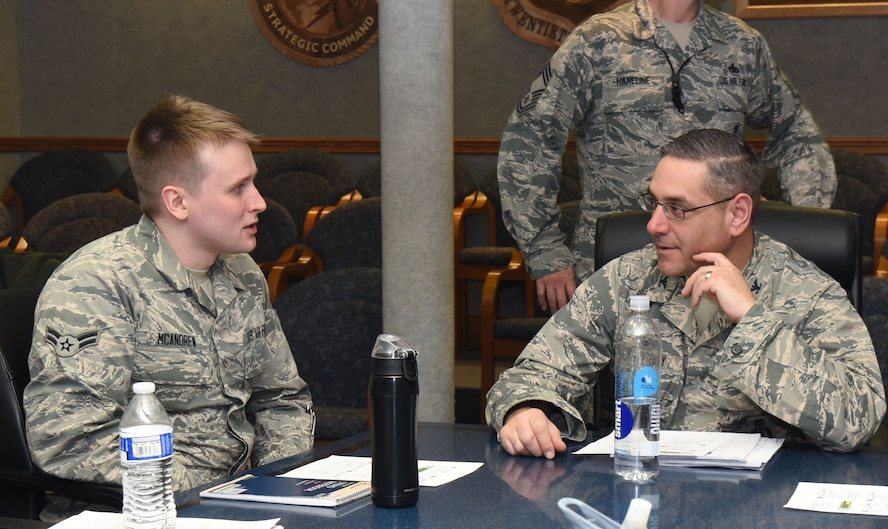 Col. Stephen Kravitsky, 90th Missile Wing commander, talks to Airman 1st Class Joseph McAndrew, 90th Logistics Readiness Squadron traffic management technician, after a meeting in the wing conference room at F.E. Warren Air Force Base, Wyo., Jan. 11, 2017. Attending this meeting and shadowing Kravitsky for the day gave McAndrew insight into how the wing operates. (U.S. Air Force photo by Airman 1st Class Breanna Carter)