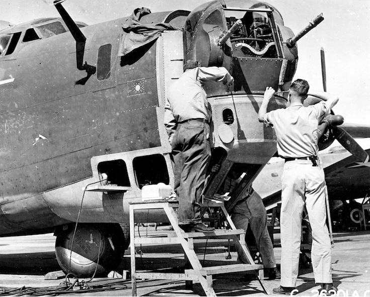 Work on a modification to the B-24D nose turret takes place at Tinker Field. The major modification on 65 B-24D Liberators began July 15, 1943. (Photo courtesy of Tinker History Office)