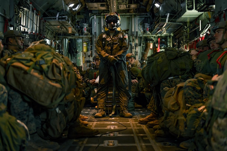 Staff Sgt. Benjamin J. Shest, 36th Airlift Squadron loadmaster, and Marines with the 3rd Reconnaissance Battalion, 3rd Marine Division, III Marine Expeditionary Force, wait in a C-130 Hercules before a static line parachute drop on Jan. 11, 2017, at Yokota Air Base, Japan. The Marines work with the 36th Airlift Squadron four times a year to help maintain jump qualifications and promote bilateral training. (U.S. Air Force photo by Airman 1st Class Donald Hudson)