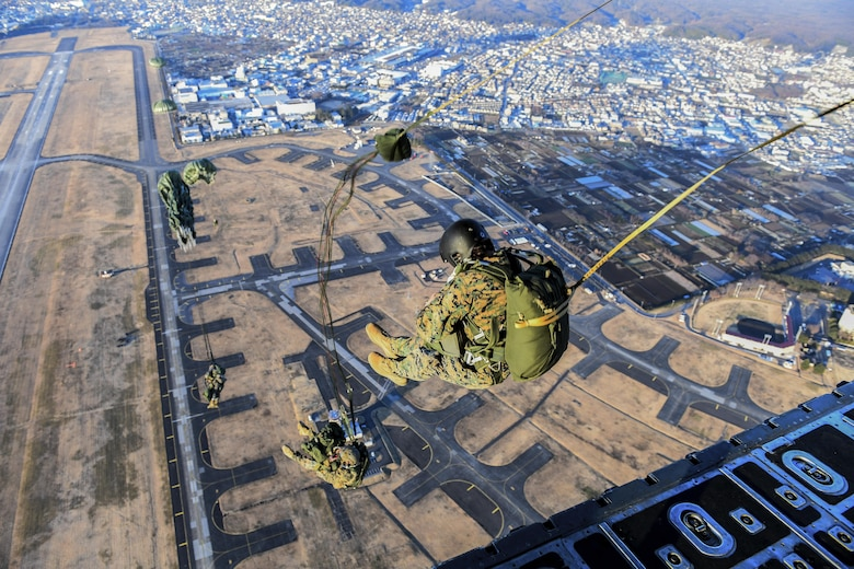 Marines with the 3rd Reconnaissance Battalion, 3rd Marine Division, III Marine Expeditionary Force, perform a static line parachute jump on Jan. 11, 2017, at Yokota Air Base, Japan. The 36th Airlift Squadron provided airlift supports to U.S. Marine Corp's weeklong jump training. (U.S. Air Force photo by Airman 1st Class Donald Hudson)