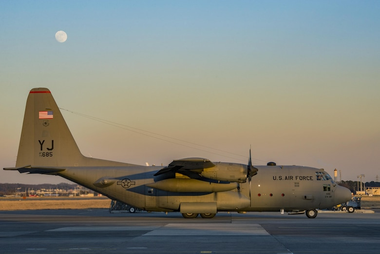 A C-130 Hercules prepares to park on the flight line after a day of personnel static line jump exercises on Jan. 11, 2017, at Yokota Air Base, Japan. Marines work with the 36th Airlift Squadron four times a year to help maintain jump qualifications and promote bilateral training. (U.S. Air Force photo by Airman 1st Class Donald Hudson)