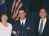 Fred Brooks, now the 21st Civil Engineer Squadron installation management chief, poses for a photo with his mother Barb and step-father Earl during his Air Force commissioning.