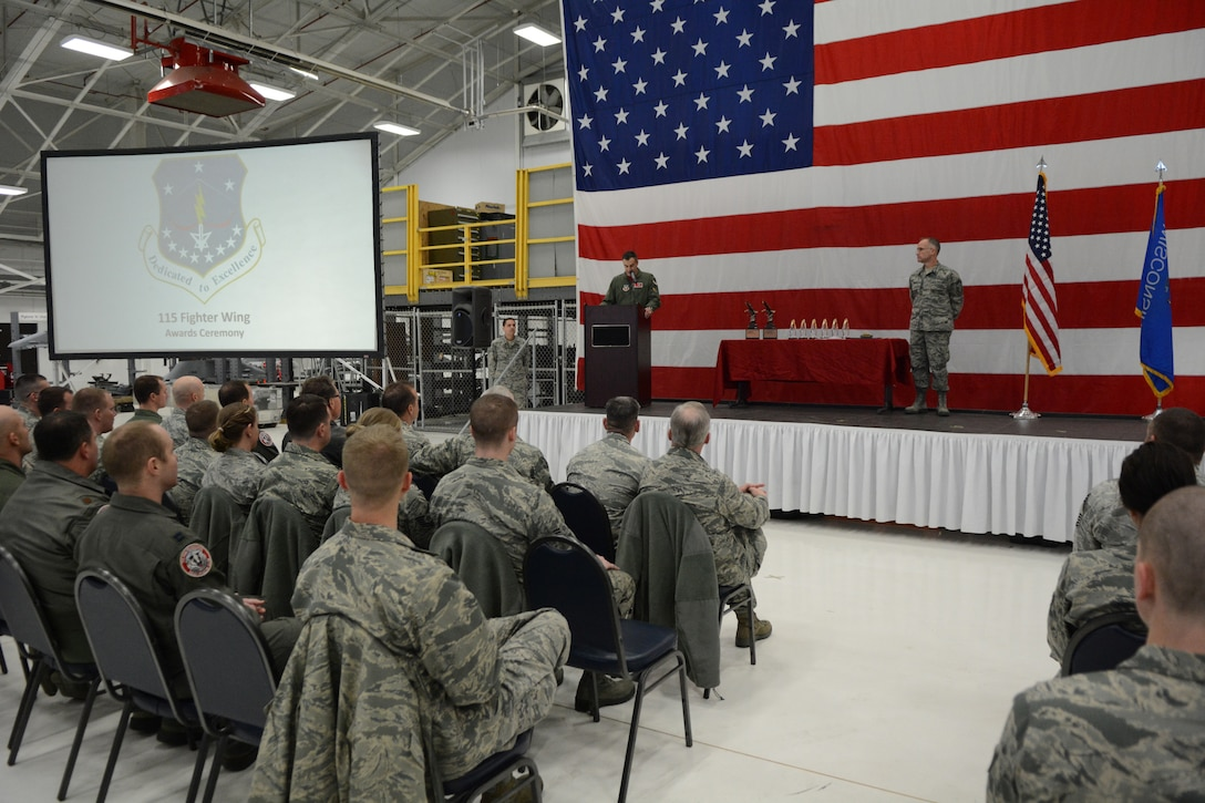 Col. Erik Peterson, 115th Fighter Wing commander, addresses Airmen from across the base at the 2016 Awards Ceremony in Hangar 406 on Jan. 7, 2017. During the ceremony, there were eight categories of awards presented, including Airman of the Year, Non-commissioned Officer of the Year and Company Grade Officer of the Year, among others. (U.S. Air National Guard photo by Staff Sgt. Kyle Russell)