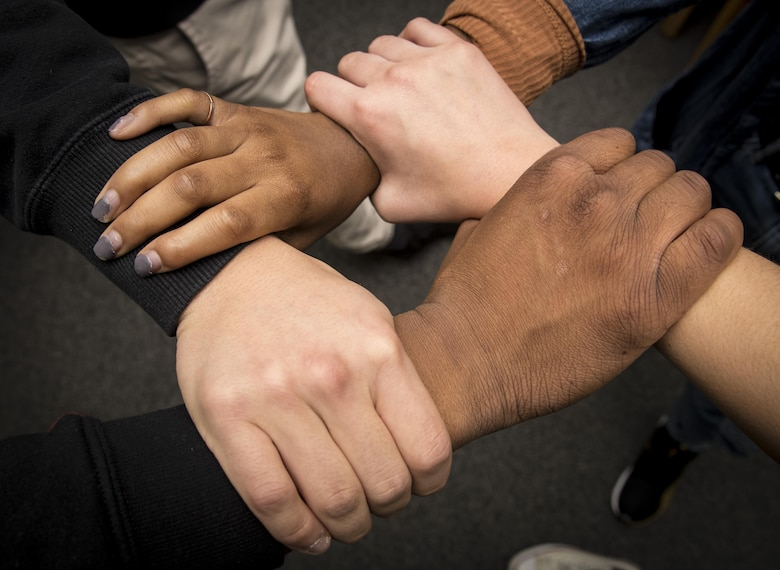 """Edgren High School students grasp each other's wrist symbolizing equality among all people at Misawa Air Base, Japan, Jan. 11, 2017. On Aug. 28, 1963, Martin Luther King Jr., gave his """"I Have a Dream,"""" speech as a part of the African-American Civil Rights stance against racism. (U.S. Air Force photo by Airman 1st Class Sadie Colbert)"""