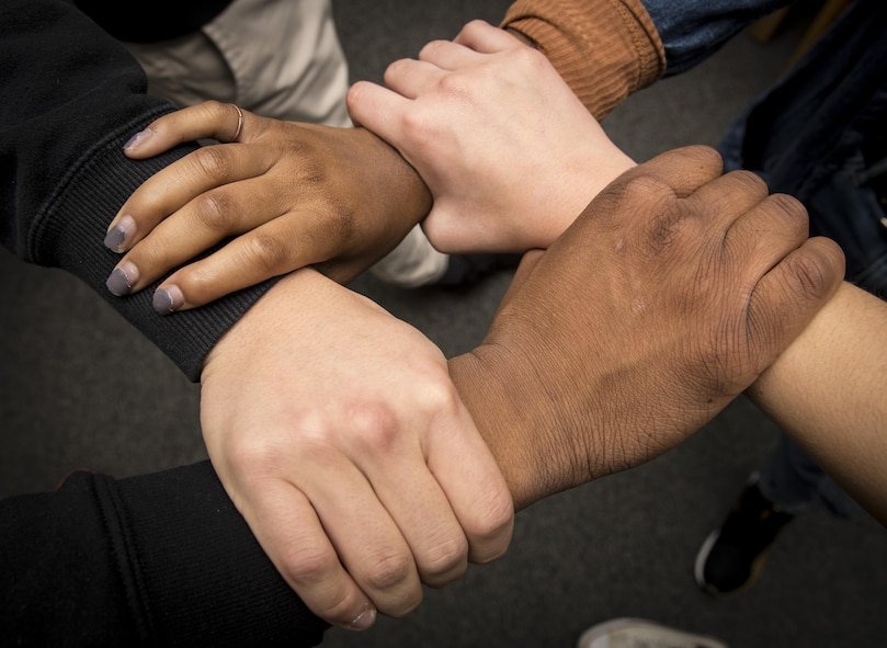 "Edgren High School students grasp each other's wrist symbolizing equality among all people at Misawa Air Base, Japan, Jan. 11, 2017. On Aug. 28, 1963, Martin Luther King Jr., gave his ""I Have a Dream,"" speech as a part of the African-American Civil Rights stance against racism. (U.S. Air Force photo by Airman 1st Class Sadie Colbert)"