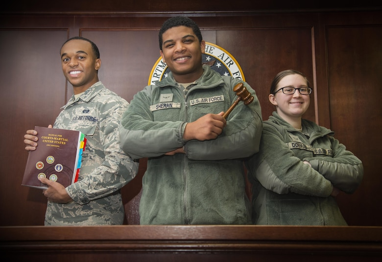 """U.S. Air Force Senior Airman Jamel Smith, left, Airman Robert Sheran, center, and Airman 1st Class Whitney Dorman, right, pose in the court room at Misawa Air Base, Japan, Jan. 12, 2017. During the African-American Civil Rights Movement, laws such as """"Brown v. Board of Education,"""" """"Voting Rights Act of 1965"""" and the """"Civil Rights Act of 1968,"""" initiated the end of racism in America. (U.S. Air Force photo by Airman 1st Class Sadie Colbert)"""