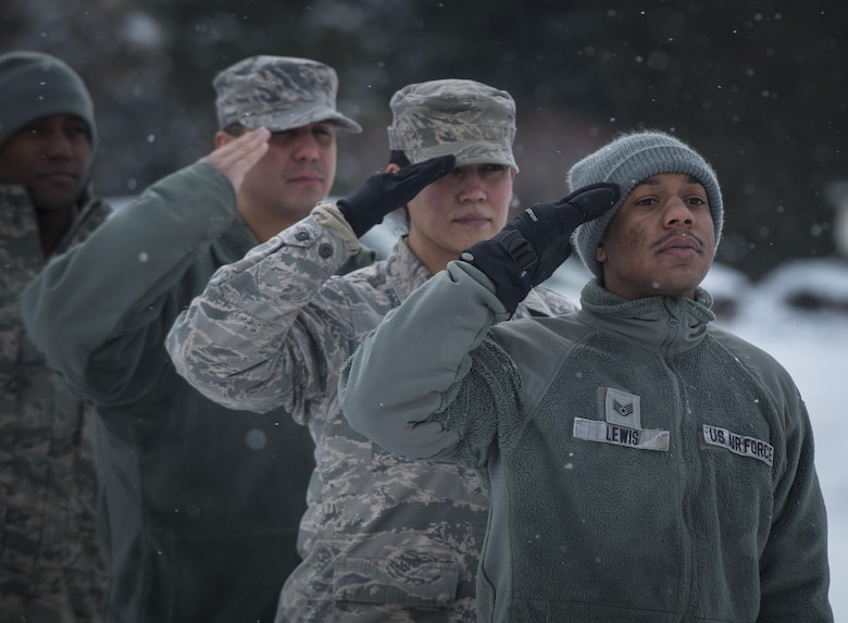 """U.S. Air Force Airmen with the 35th Fighter Wing staff agencies stand and salute at Misawa Air Base, Japan, Jan. 12, 2017. On July 26, 1948, former President Harry S. Truman signed an executive order declaring, """"There shall be equality of treatment and opportunity for all persons in the armed services without regard to race, color, religion or national origin."""" To this day, that legacy of inclusion continues in the U.S. armed forces for all who serve. (U.S. Air Force photo by Airman 1st Class Sadie Colbert)"""