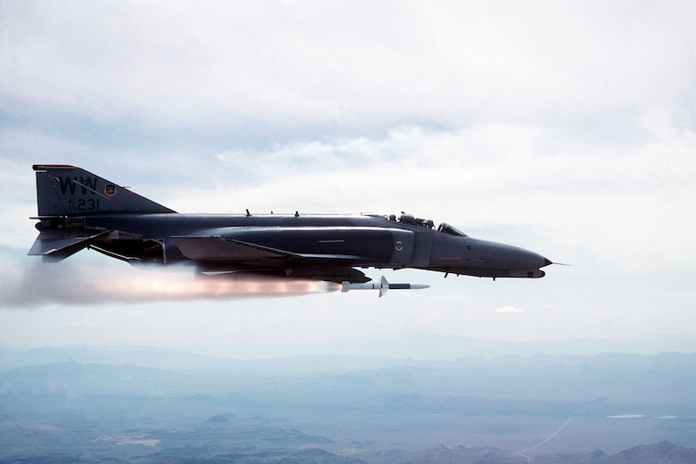 """As a part of Operation Desert Storm, January – February, 1991, an F-4G Phantom launches a munition as a part of a Suppression of Enemy Air Defense mission during World War II. Since then, Misawa Air Base's role transformed with the F-16 Fighting Falcon by contributing to Pacific Air Force's """"Rebalance"""" priority by building peace and prosperity for all nations across the Pacific region. (Courtesy Photo)"""