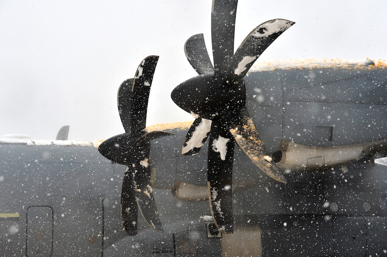 Snow and de-icing fluid stick to the propellers and engines on a C-130J Super Hercules at Ramstein Air Base, Germany, Jan. 10, 2017 The 86th Aircraft Maintenance Squadron conducted de-icing procedures on aircraft after a heavy snowfall on the installation and surrounding areas. The fluid helps prevent build-up of snow for a certain amount of time. (U.S. Air Force photo by Airman 1st Class Joshua Magbanua)