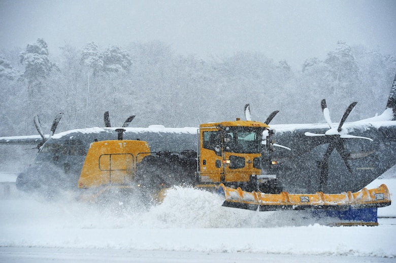A snow plow removes snow on the flightline at Ramstein Air Base, Germany, Jan. 10, 2017. Snow removal operations commenced throughout Ramstein as continuous heavy snow persisted throughout the majority of the day. Other snow removal operations included de-icing aircraft and applying salt to roads and walkways. (U.S. Air Force photo by Airman 1st Class Joshua Magbanua)