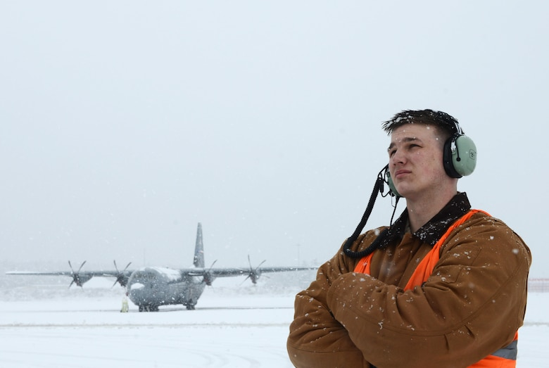 Senior Airman Damian Halpin, 86th Aircraft Maintenance Squadron crew chief, stands on the flightline as he observes de-icing operations for aircraft at Ramstein Air Base, Germany, Dec. 10, 2017. The installation conducted snow removal operations throughout the installation as continuous heavy snowfall persisted throughout the majority of the day. (U.S. Air Force photo by Airman 1st Class Joshua Magbanua)