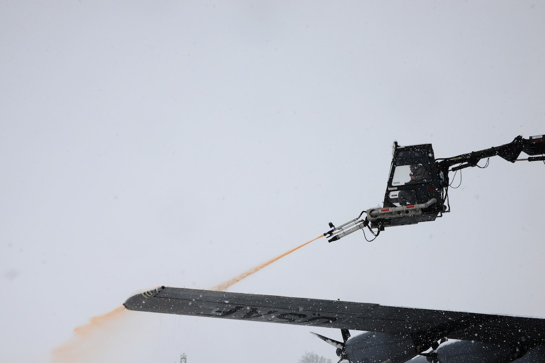 A de-icing vehicle sprays a de-icing fluid onto the wing of a C-130J Super Hercules Aircraft at Ramstein Air Base, Germany, Jan. 10, 2017. Continuous heavy snowfall prevailed throughout the majority of the day, prompting snow removal operations across the installation. The fluid helps prevent build-up of snow for a certain amount of time, especially before flight. (U.S. Air Force photo by Airman 1st Class Joshua Magbanua)