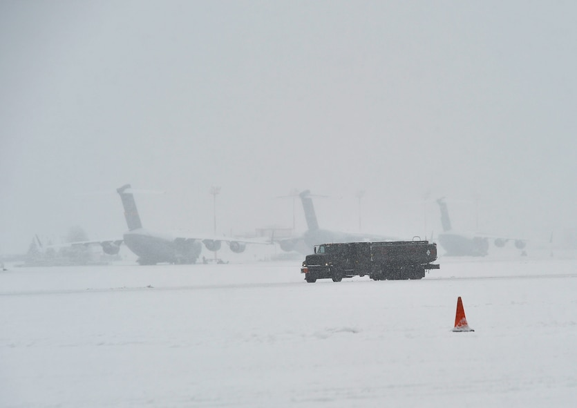 A military fuel truck drives on the flightline at Ramstein Air Base, Germany, Jan. 10, 2017. The Kaiserslautern Military Community received a record snowfall of approximately 3 1/2 inches in one day, making it the largest snowfall in a 24-hour period in the area since 2009. Local weather studies report that the state of Rheinland-Pfalz receives an average of 24.4 inches of precipitation each year. (U.S. Air Force photo by Airman 1st Class Joshua Magbanua)