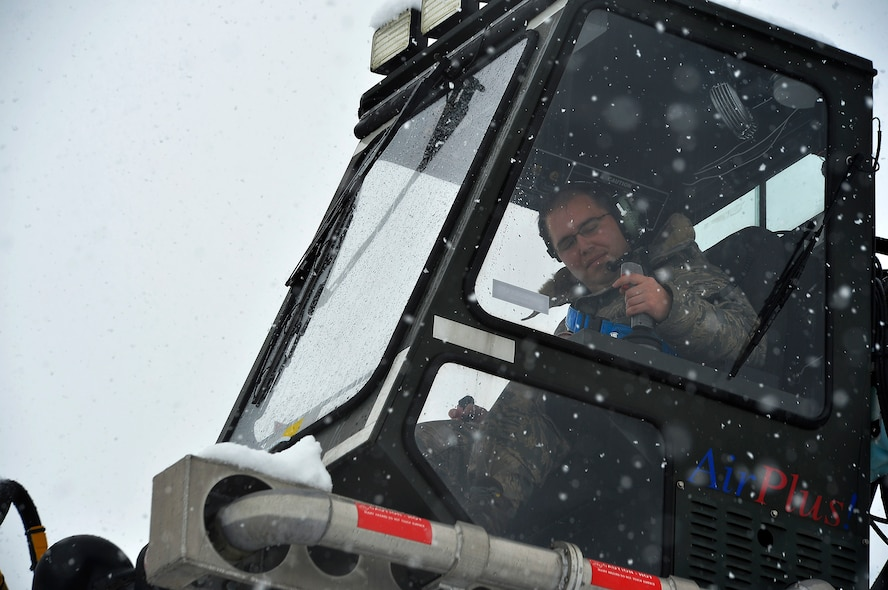 Staff Sgt. Brian Leddon, 86th Aircraft Maintenance Squadron missions systems craftsman, operates a de-icing vehicle at Ramstein Air Base, Germany, Jan. 10, 2017. More than three inches of snow fell in the area, prompting snow removal operations throughout the base. The operations included plowing snow, de-icing aircraft, and applying salt on roads and walkways. (U.S. Air Force photo by Airman 1st Class Joshua Magbanua)