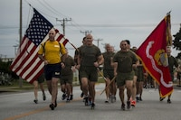 Maj. Gen. Richard L. Simcock II, commanding general of 3rd Marine Division, runs with his Marines and Sailors prior to his change of command on Camp Hansen, Okinawa, Japan, Jan. 12, 2017. The run celebrated the accomplishments of each Division Marine and Sailor during Simcock's time in the command.