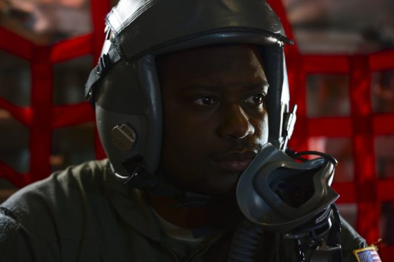 Senior Airman Earnest Powell, a physiology technician (PT) assigned to the 19th Aerospace Medicine Squadron High Altitude Airdrop Mission Support Center, Little Rock Air Force Base, Ark., participates in a high-altitude mission, Nov. 16, 2016. PTs are responsible for ensuring aircrew are receiving proper amounts of oxygen while flying at altitudes above 20,000 feet. (U.S. Air Force photo/Staff Sgt. Kenny Holston)