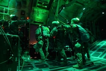 Airmen assigned to the 19th Aerospace Medicine Squadron High Altitude Airdrop Mission Support Center (HAAMSOC), Little Rock Air Force Base, Ark., jump out of a C-130J Hercules for a high-altitude mission, Nov. 16, 2016. The HAAMS Airmen are specially trained to provide in-flight physiological support to aircrews, special operations forces, high altitude parachutists, and other DoD agencies that perform unpressurized airdrop operations at 20,000 feet mean sea level and above. (U.S. Air Force photo/Staff Sgt. Kenny Holston)