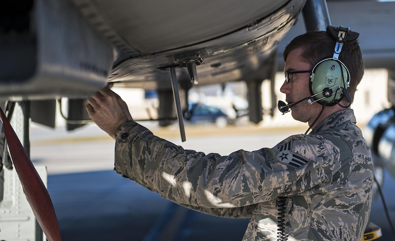 Senior Airman John Johnson, 23d Aircraft Maintenance Squadron crew chief, performs a pre-flight inspection on an A-10C Thunderbolt II, Jan. 12, 2017, at Moody Air Force Base, Ga. Pilots, aircraft and maintainers traveled to Nellis Air Force Base in Las Vegas to participate in Green Flag-West. (U.S. Photo by Airman 1st Class Janiqua P. Robinson)
