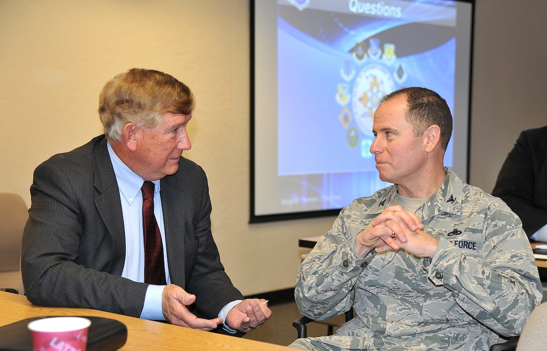 Former Assistant Secretary of the Air Force for Installations, Environment and Logistics Terry Yonkers (left) discusses the Enhanced Use Lease program with 377th Air Base Wing Commander Col. Eric Froehlich Jan 11 during the Industry Day at Phillips Technology Institute here. Yonkers is representing a private-sector group interested in leasing land on Kirtland Air Force Base's