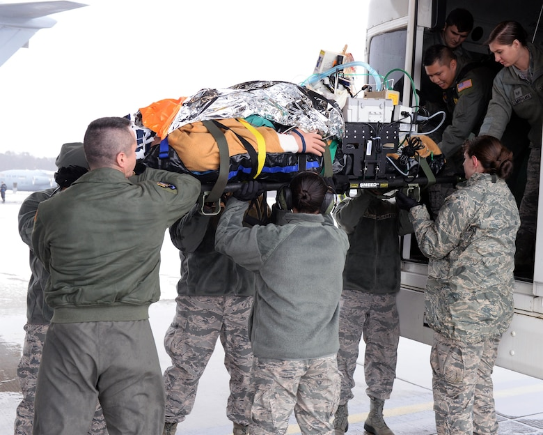 Airmen receive a simulated critical care patient from a transport vehicle during an exercise at Ramstein Air Base, Germany, Jan. 11, 2017. Patients who are in critical status are accompanied by critical care air transportation teams who ride and fly with them until they reach their destination. (U.S. Air Force photo by Senior Airman Jimmie D. Pike)