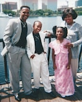 During his childhood, Hilliard Kelly III, second from left, and his family endured many setbacks, including the loss of his father, Hilliard Kelly II, left, an Army veteran. But they persevered, and the family is now doing well. Courtesy photo