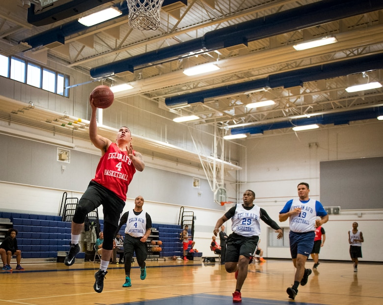 A Medical Group Black player drives to the basket for a lay-up during an intramural basketball game against the Maintenance Squadron team at Eglin Air Force Base, Fla., Jan. 12.  The MDG team won easily 30 to 25 in their first game of the new intramural season.  (U.S. Air Force photo/Samuel King Jr.)