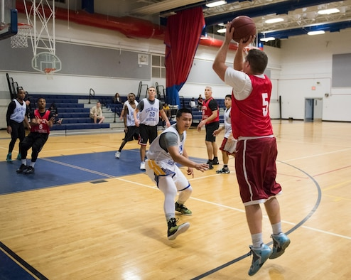 A Medical Group Black player shoots a three-pointer late into their intramural basketball game against the Maintenance Squadron team at Eglin Air Force Base, Fla., Jan. 12.  The MDG team won easily 30 to 25 in their first game of the new intramural season.  (U.S. Air Force photo/Samuel King Jr.)