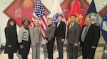 DLA Distribution deputy commander Twila Gonzales, Senior Executive Service, third from left, poses with the DLA Distribution honorees at the 49th annual employee recognition ceremony Dec. 15. From left to right are Rowena Gadin, Sandra Stephens, Gonzales, Barbara Eberly, Cathy Hampton, Jose Acosta and Kevin Henderson.