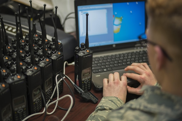 Senior Airman Jason Geiger, 744th Communications Squadron radio frequency transmission system technician, programs a land mobile radio on Joint Base Andrews, Md., Jan. 11, 2017. The 744th CS distributed approximately 200 LMRs to Airmen participating in the 58th Presidential Inauguration. Keeping Airmen connected is one of the 744th CS's primary mission during the inauguration. (U.S. Air Force photo by Airman 1st Class Valentina Lopez)