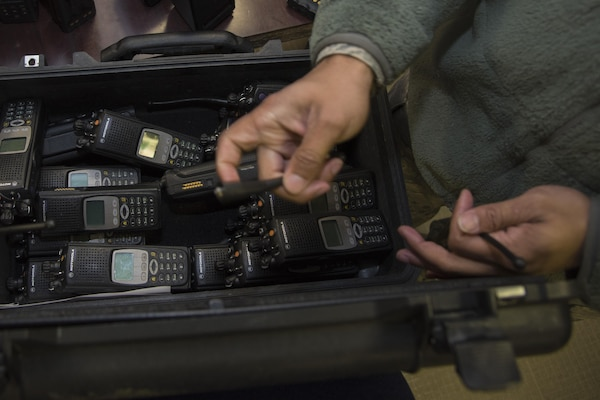 A 744th Communications Squadron radio frequency transmission system technician prepares land mobile radios for pick up on Joint Base Andrews, Md., Jan. 11, 2017. The 744th CS plays an important role in ensuring communication is running smoothly. Airmen participating in the 58th Presidential Inauguration will be using approximately 200 LMRs provided by the 744th CS.  (U.S. Air Force photo by Airman 1st Class Valentina Lopez)