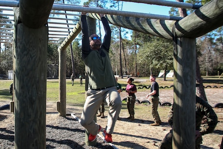 Alan Parmenter, a teacher at Mitchell High School, Florida, participates in the Confidence Course during the Educators Workshop aboard Marine Corps Recruit Depot Parris Island, South Carolina, Jan. 12, 2017. The educators come from Recruiting Stations Fort Lauderdale and Orlando to experience the workshop. The Educators Workshop provides an opportunity to educators to have an inside look at Marine Corps traning to better inform the students in their local area. (U.S. Marine Corps photo by Lance Cpl. Jack A. E. Rigsby/Released)