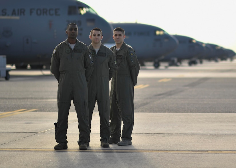 Capt. James Hall, 14th Airlift Squadron (AS) tactics flight commander, left, Capt. Matt Eggert, 16th AS pilot, center, Capt. Jeff Harnly, 16th Airlift Squadron evaluator, right, stand on the flightline here, Jan. 12, 2017. Hall, Eggert and Harnly recently graduated from the U.S. Air Force Weapons School where they learned to be tactical experts in C-17 Globemaster IIIs as well as experts in integration across all platforms in the Air Force.