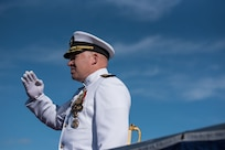 170106-N-KC128-0092 JOINT BASE PEARL HARBOR-HICKAM, Hawaii (January 6, 2017) Capt. Michael Martin, commanding officer of Naval Submarine Training Center, Pacific, renders honors during a change of command ceremony on Joint Base Pearl Harbor-Hickam. Capt. Andrew Hertel relieved Martin as commanding officer of Naval Submarine Training Center, Pacific. (U.S. Navy photo by Mass Communication Specialist 1st Class Daniel Hinton)