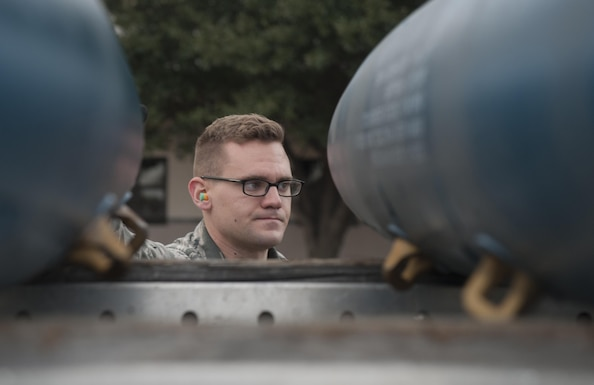 U.S. Air Force Senior Airman Andrew Mote, 7th Munitions Squadron gold team member, looks over several BDU-50 low-drag munitions during the 7th MUNS quarterly bomb build competition at Dyess Air Force Base, Texas, Jan. 12, 2017. This was the fifth quarterly bomb build competition that has helped more than 100 competitors improve technical skills and proficiency. (U.S. Air Force photo by Airman 1st Class Rebecca Van Syoc)