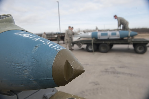 U.S. Air Force Airmen from the 7th Munitions Squadron assemble the last pieces onto four GBU-31 V1 joint direct attack munitions at Dyess Air Force Base, Texas, Jan. 12, 2017. The competition lasted just over an hour, with both teams assembling a total of 38 munitions. (U.S. Air Force photo by Airman 1st Class Rebecca Van Syoc)
