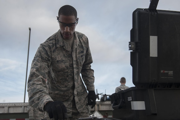 U.S. Air Force Airman 1st Class Andre McRae, 7th Munitions Squadron green team member, selects a tool from a toolkit during the 7th MUNS quarterly bomb build competition at Dyess Air Force Base, Texas, Jan. 12, 2017. The munitions built during the competition are slotted for use during future B-1B Lancer training missions. (U.S. Air Force photo by Airman 1st Class Rebecca Van Syoc)