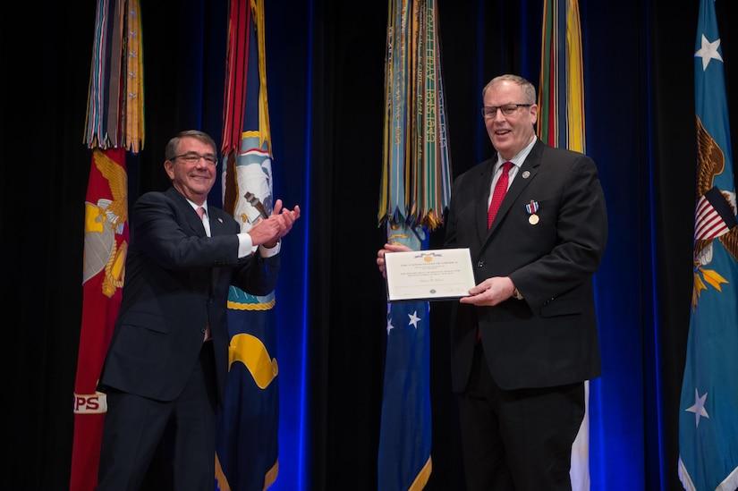 Defense Secretary Ash Carter hosts Deputy Defense Secretary Bob Work during Work's farewell ceremony at the Pentagon in Washington, D.C., Jan. 13, 2017. DoD photo by Army Sgt. Amber I. Smith