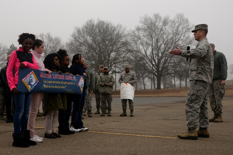 U.S. Air Force Col. Charles Brown, 19th Airlift Wing commander, kicked off the Martin Luther King Jr. commemorative walk with opening remarks January 13, 2017, at Little Rock Air Force Base, Ark. The event began at the Herk Hall and participants marched to the nearby Walters Community Support Center. (U.S. Air Force photo by Airman 1st Class Codie Collins)