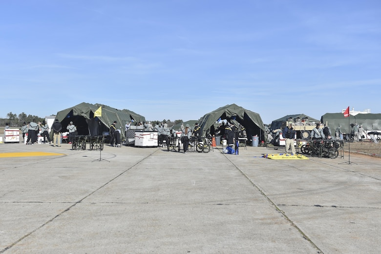 Soldiers from the 414th Chemical, Biological, Radiological and Nuclear Company and the 409th Area Support Medical Company setup temporary treatment facilities, consisting of five tents, during a mass casualty and decontamination exercise at North Auxiliary Airfield in North, South Carolina Jan. 10, 2017. Both units work hand-in-hand to setup a treatment center capable of decontaminating and caring for victims of a CBRN attack within two and a half hours of arriving on scene. North Auxiliary Airfield is a Joint Base Charleston asset capable of hosting a wide range of exercises.