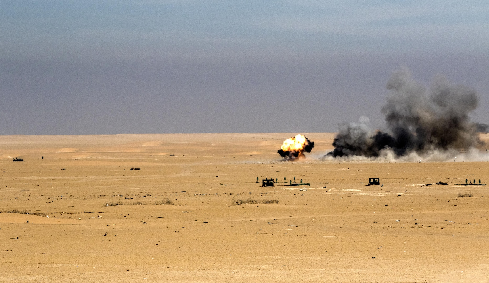 "An M30A1 explodes on target vehicles configured into a convoy at Udairi Training Range in Kuwait, recently. The munitions are being used to replace ""cluster bomb"" munitions with tungsten steel pellets to target soft vehicles and enemy personnel without leaving potential unexploded ordinance on the battlefield. (U.S. Army photo by Sgt. Brandon Hubbard, USARCENT Public Affairs)"