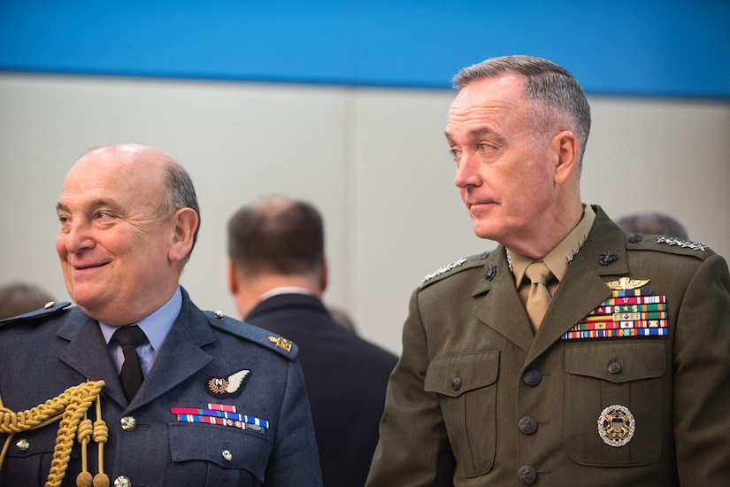 Marine Corps Gen. Joe Dunford, chairman of the Joint Chiefs of Staff, speaks with Air Chief Marshal Sir Stuart Peach, the United Kingdom's chief of defense, before a meeting of the NATO Military Committee alliance at the alliance's headquarters in Brussels, Jan. 17, 2017. DoD photo by Army Sgt. James K. McCann