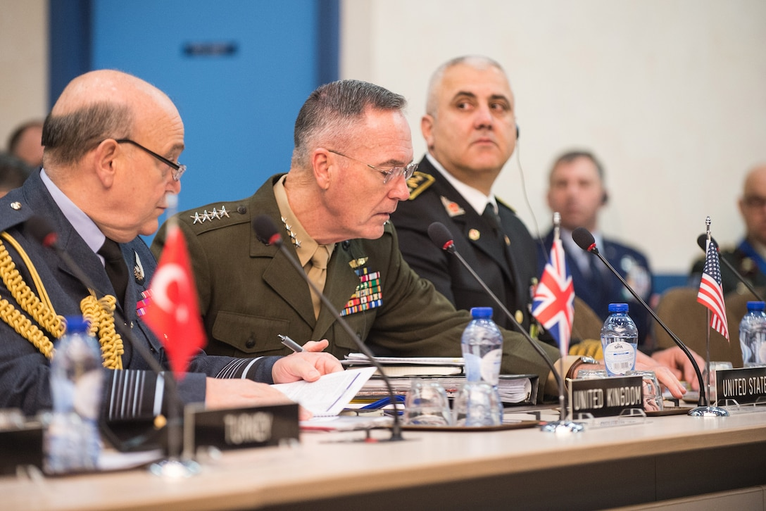 Marine Corps Gen. Joe Dunford, chairman of the Joint Chiefs of Staff, meets with his counterparts at a NATO meeting in Brussels.
