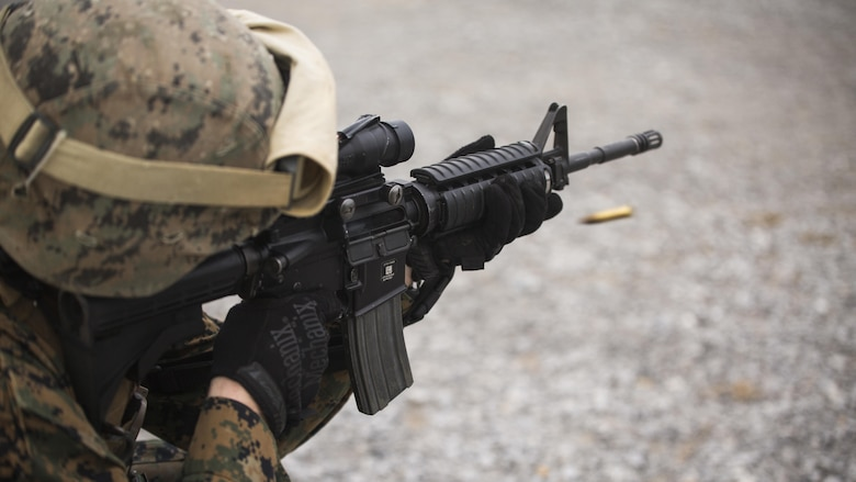 Capt. Ian Carter-Condon fires an M16A4 service rifle during table two of his annual rifle range qualification, Jan. 12, 2017, at Camp Hansen, Okinawa, Japan. The Marine Corps revised table two of the marksmanship program October 2016 to increase marksmanship skill and realism in a combat environment. Carter-Condon is an assistant operations officer with Combat Logistics Regiment-3, 3d Marine Logistics Group, III Marine Expeditionary Force.