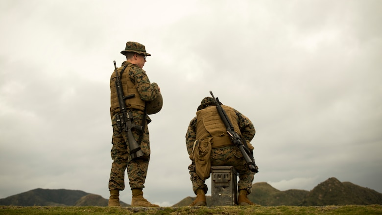 Marines await their turn to shoot the table two portion of their annual rifle range qualification, Jan. 12, 2017, at Camp Hansen, Okinawa, Japan. The Marine Corps revised table two of the marksmanship program October 2016 to increase marksmanship skill and realism in a combat environment. The Corps requires Marines to annually qualify at the range to determine their marksmanship skill.